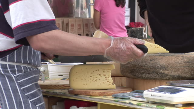 cu, vendor cutting cheese, mid section, kinsale, ireland - cheese stock videos & royalty-free footage