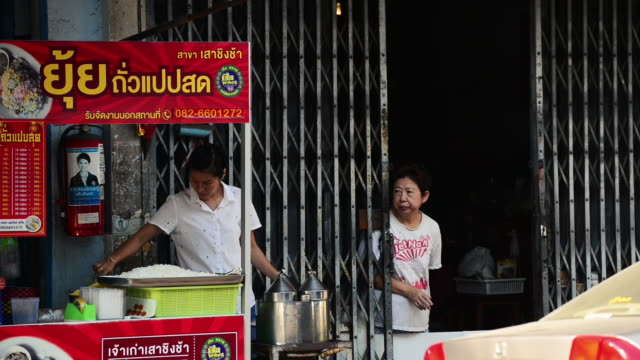 a vendor is cooking thai crepe in preparation to sell it in the morning - routine stock videos & royalty-free footage