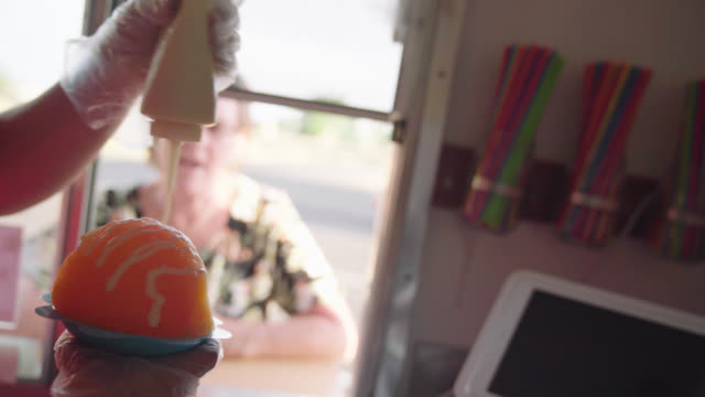 vendor makes shave ice - concession stand stock videos and b-roll footage