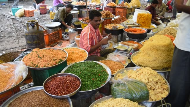 vendor making snacks. - market stall stock videos & royalty-free footage