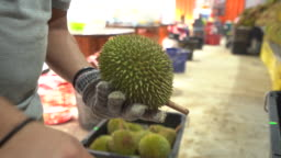 Vendor opening freshness durian at market store at Malaysia