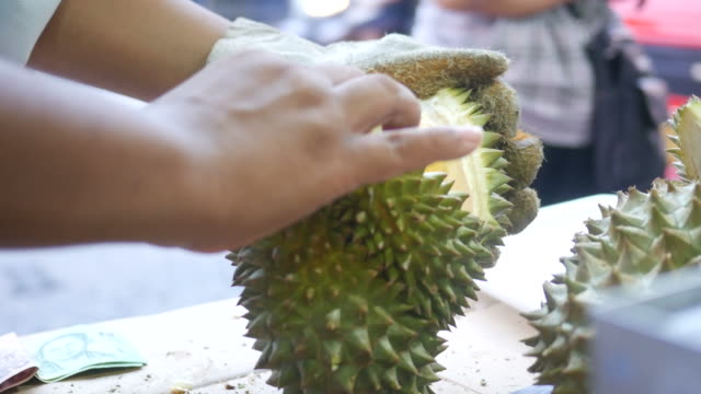 vendor peeling durian - peel plant part stock videos and b-roll footage