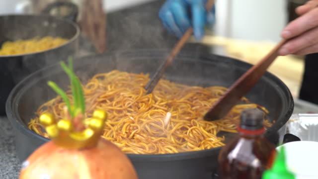 vendor preparing noodles - tilt down stock videos & royalty-free footage