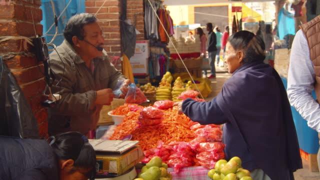 vendor selling shrimps in a street market in san cristobal de las casas, mexico - local produce stock videos & royalty-free footage