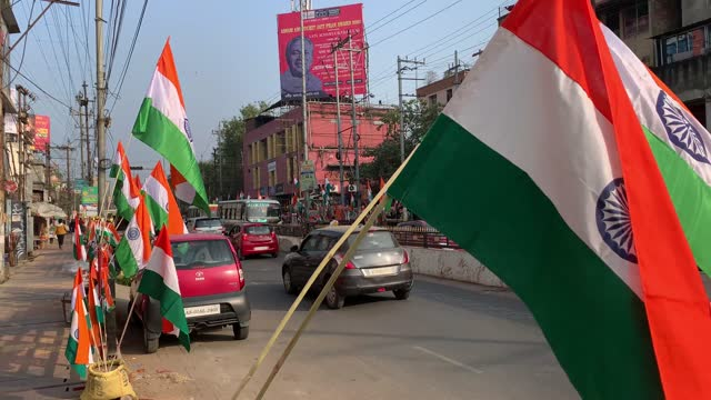 vendor selling tricolor or indian flag and tricolor items in the street in the eve of 71st republic day celebrations, on 25 january 2021 in gauhati,... - india flag stock videos & royalty-free footage
