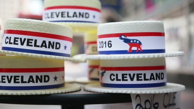 a vendor sells hats on euclid avenue for the 2016 republican national convention in downtown cleveland the day before it began - republikanischer parteitag stock-videos und b-roll-filmmaterial