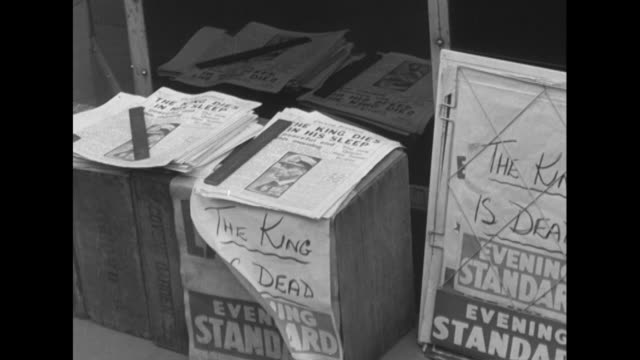 a vendor sells newspapers announcing the death of king george vi - george vi of the united kingdom stock videos & royalty-free footage