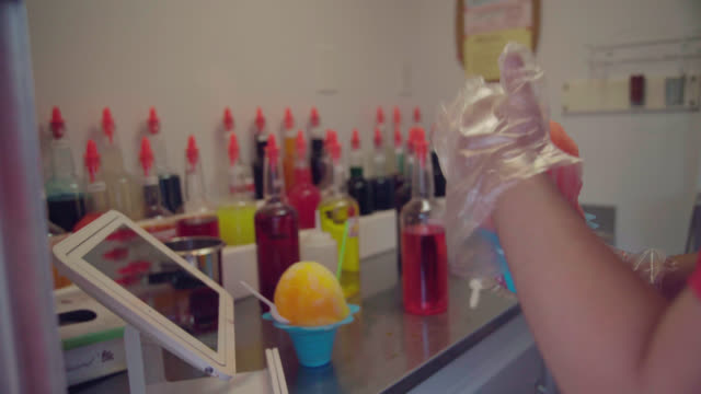 vendor serves up some shave ice - popsicle stick stock videos and b-roll footage