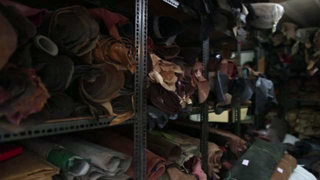 vídeos y material grabado en eventos de stock de vendor uses a mobile phone while waiting for customers at the heera enterprises leather store in the dharavi area of mumbai, india, on tuesday, july... - iva