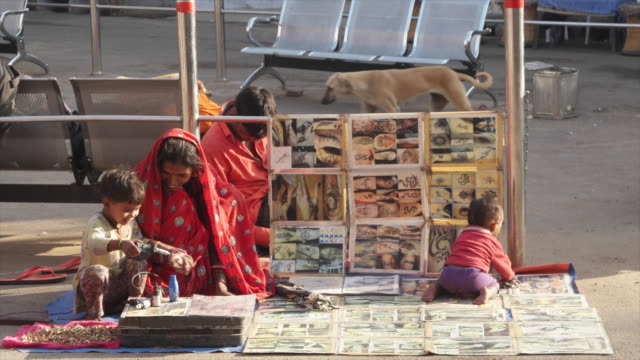 vendor with kids selling tattoos and jewelry at pushkar mela fair it comes alive with vibrant folk music and dances horse and camel races religious... - body adornment stock videos and b-roll footage
