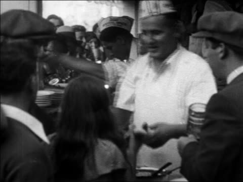 b/w 1930 vendors at nathans hot dog stand serrving hot dogs to customers / coney island, nyc - coney island brooklyn stock videos & royalty-free footage