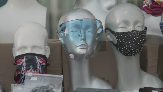 vendors sell face masks and face shields at the inner harbor on march 12, 2021 in baltimore, maryland. there have been 391,480 total confirmed cases... - small group of objects stock videos & royalty-free footage