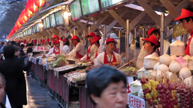 Vendors sell traditional foods at the Snack Street Market along Wangfujing Street in Beijing, China.