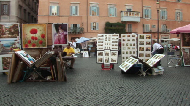 pan vendors selling art at street market / rome, lazio, italy - letterbox format stock videos and b-roll footage