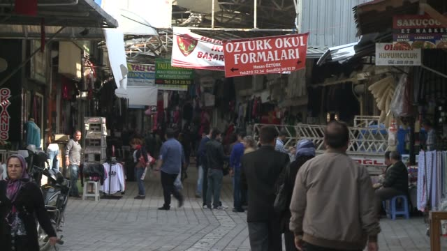 MS of vendors shoppers Turkish people walking through souk in Antakya Turkey near the border with Syria