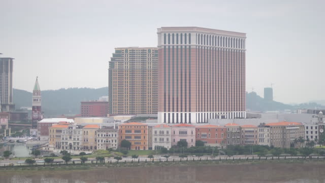 Venetian Macao ResortHotel complex vehicles driving across street city buildings mountains BG Casinos gambling gaming entertainment luxury vacation...