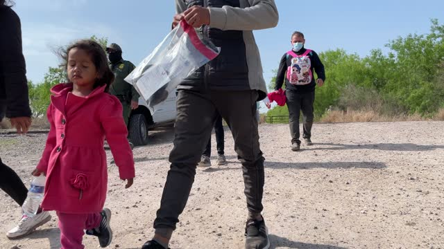 venezuelan family walks with other migrants to enter a u.s. border patrol transport bus after crossing the border from mexico into the united states... - crossing stock videos & royalty-free footage