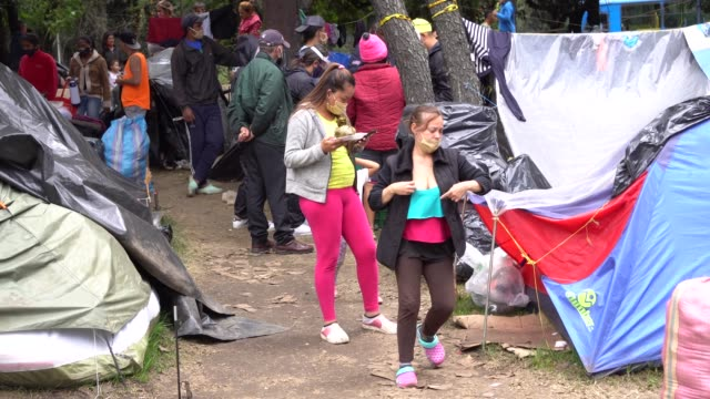 venezuelan inhabitants eat local food in a camp in bogotá colombia on thursday june 25 2020 approximately 400 venezuelans are living sleeping in this... - refugee camp stock videos & royalty-free footage