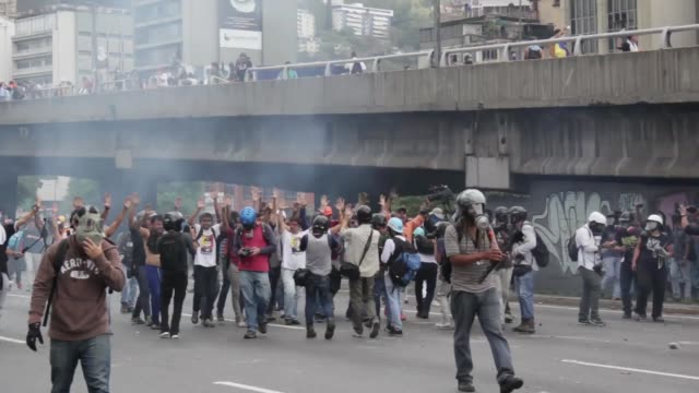 venezuelan opposition activist clashes wiht police in caracas on april 6, 2017. the center-right opposition vowed fresh street protests -after... - venezuela stock videos & royalty-free footage