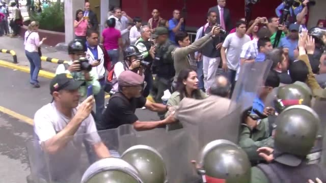 A Venezuelan opposition lawmaker was injured Thursday when police fired tear gas and forcefully broke up protesters demanding the authorities move...