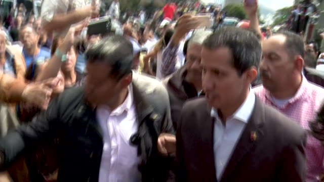 stockvideo's en b-roll-footage met venezuelan opposition leader dismounts from bed of truck where he has been addressing rally of transportation workers he's mobbed by supporters and... - vakbond