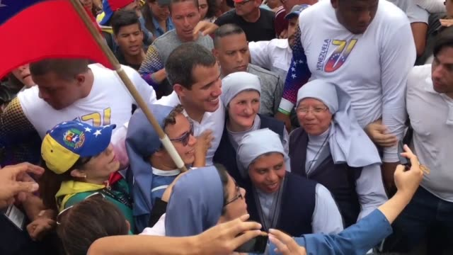 vídeos de stock, filmes e b-roll de venezuelan opposition leader juan guaido addresses his decision to send delegates to oslo for talks with representatives of president nicolas... - send