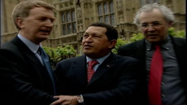 venezuelan president hugo chavez defiant despite us arms embargo westminster houses of parliament chavez shaking hands with unidentified officials - ウゴ・チャベス点の映像素材/bロール