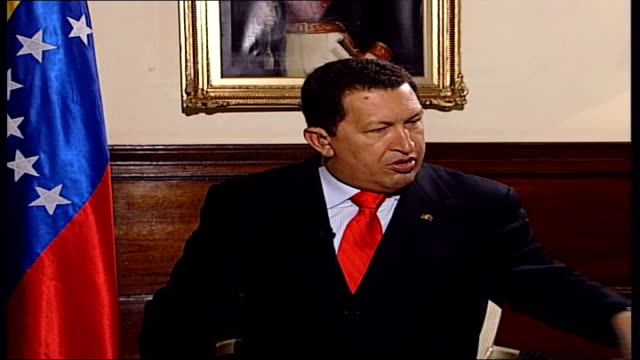 venezuelan president hugo chavez defiant despite us arms embargo england london int chavez sitting for interview as sings love song in spanish pull... - ウゴ・チャベス点の映像素材/bロール