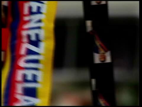 venezuelan president hugo chavez meets ken livingstone during london visit tx propagandist chavez posters and banners person at street stall selling... - ウゴ・チャベス点の映像素材/bロール