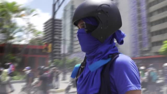 venezuelan protesters creating blockades on the streets of caracas - venezuela stock videos & royalty-free footage