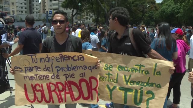 venezuelan students demonstrate against nicolas maduro's government and in favour of opposition leader juan guaido after may day clashes between... - maduro stock videos & royalty-free footage