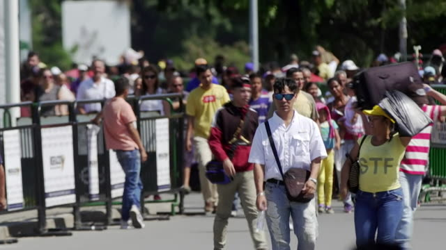 venezuelans fleeing country across venezuela colombia border - venezuela stock videos & royalty-free footage