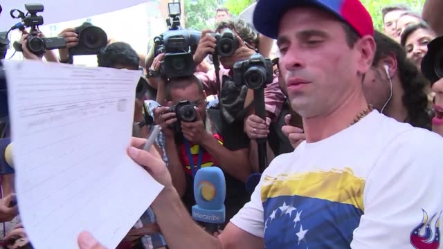 Venezuelans lined up Wednesday to seek a recall referendum against President Nicolas Maduro exasperated with a grinding crisis that has paralyzed...