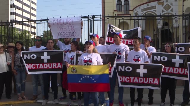 venezuelans on saturday protested at their embassy in the peruvian capital lima at the deaths of renegade helicopter pilot oscar perez and six others... - helicopter pilot stock videos & royalty-free footage