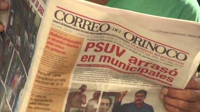 Venezuelans were divided Monday after Nicolas Maduro's party won more than 300 of Venezuela's 355 mayoral races