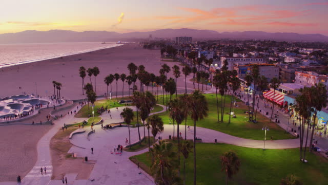 venice beach and boardwalk on colorful sunset - drone shot - venice beach stock videos & royalty-free footage