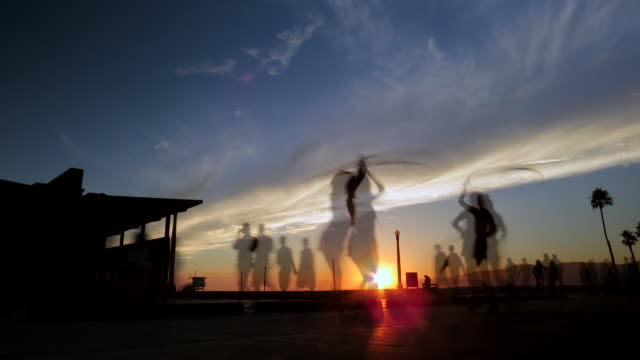 Venice beach california sunset dancers with hula hoops time lapse