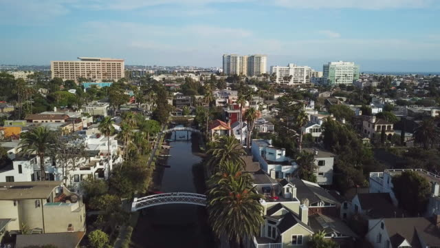 venice beach canals california - pullback aerial drone shot - canal stock videos & royalty-free footage