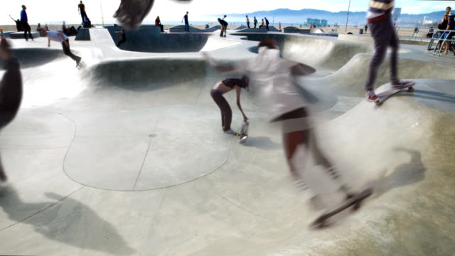venice beach cinemagraph parallax jumping skater  4k - film montage stock videos & royalty-free footage