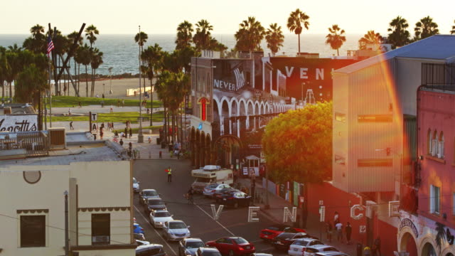 stockvideo's en b-roll-footage met venice beach seen from pacific avenue at sunset - drone shot - venice california