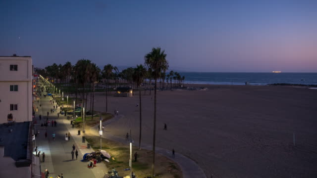 venice boardwalk on summer evening - time lapse - venice beach stock videos and b-roll footage
