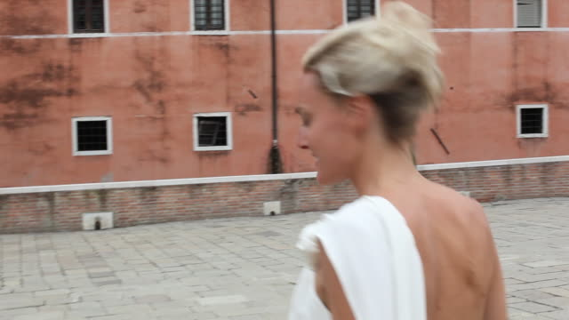 Venice, bride walking across square