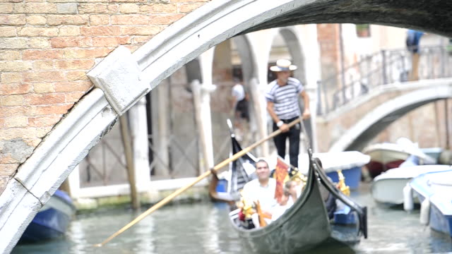 Venice bridge with passing gondola out of focus. Venice, Italy.