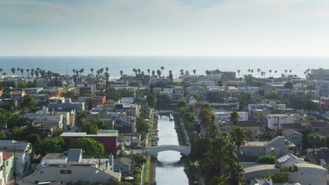 Venice Canal Historic District with Pacific Ocean Background - Drone Shot