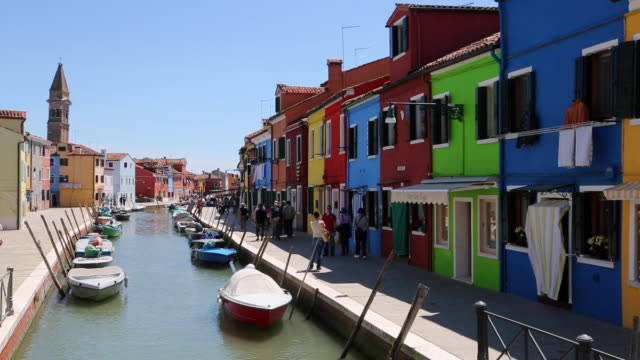 Venice, coloured houses in the canals of Burano Island, the Venetian lagoon