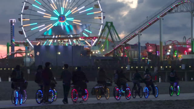 venice electric bike parade - ferris wheel stock videos & royalty-free footage