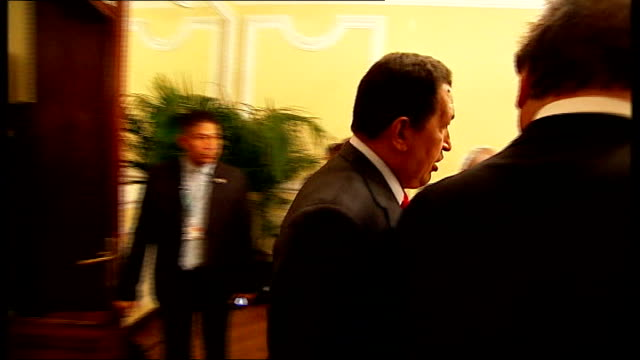 venice int hugo chavez and oliver stone into room for interview and shaking hands with reporter sot chavez and stone sitting for interview - ウゴ・チャベス点の映像素材/bロール