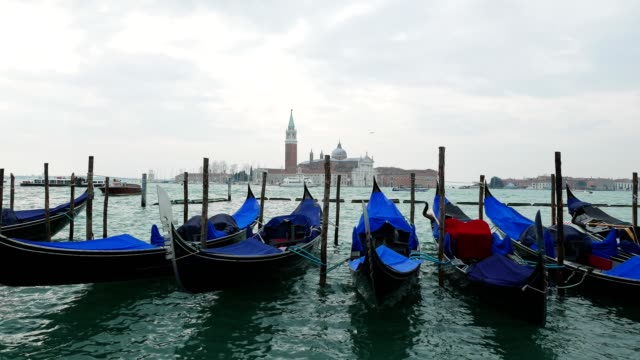 Venice, Italy, city of Romance, typical venetian sight of the gondolas anchored in the Venetian lagoon, part of series, travel destinations