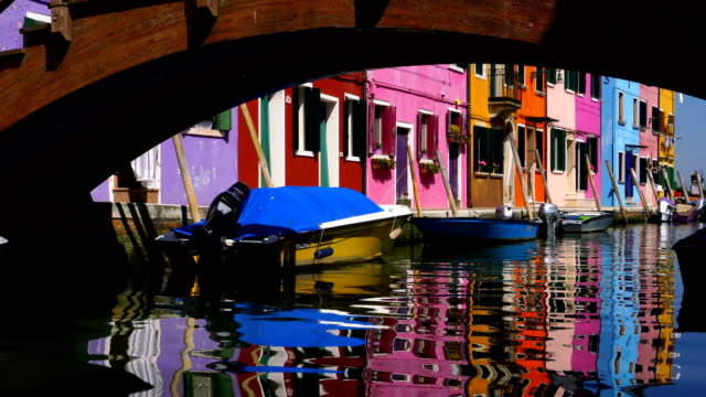 venice landmark, burano island canal, colorful houses and boats - venice italy stock videos and b-roll footage