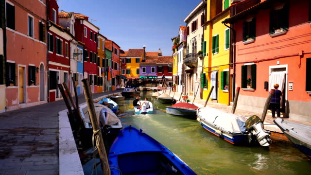 venice landmark, burano island canal, colorful houses and boats - bright colour stock videos & royalty-free footage